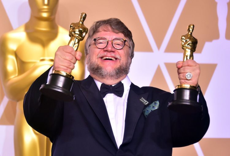 Guillermo del Toro with Oscars for The Shape of Water